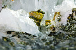 Pyrite and rock crystal. Detail of a small pyrite embedded in rock crystal and quartz crystals Royalty Free Stock Images