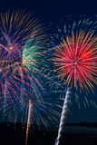 Pyrotechnia. Pyrotechnic fireworks explosions paint the evening sky with burst of vivid color and brilliant light royalty free stock images