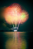 The pyrotechnic. Launch fireworks on the lake Stock Photography