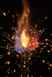 Pyrotechnic burning fire and sparks. Closeup on black background Stock Image