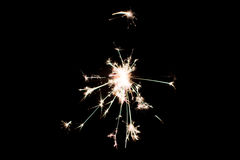 Pyrotechnic sparkler. Lighting equipment for New Year and Christmas. Stock Photos