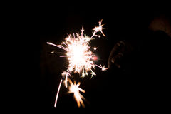 Pyrotechnic sparkler. Lighting equipment for New Year and Christmas. Royalty Free Stock Photo
