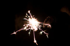 Pyrotechnic sparkler. Lighting equipment for New Year and Christmas. Royalty Free Stock Photography