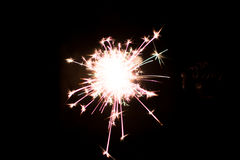 Pyrotechnic sparkler. Lighting equipment for New Year and Christmas. A sparkler is a type of hand-held firework equipment that burns slowly while emitting Royalty Free Stock Photography