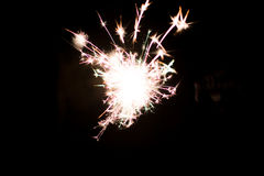 Pyrotechnic sparkler. Lighting equipment for New Year and Christmas. A sparkler is a type of hand-held firework equipment that burns slowly while emitting Stock Photo