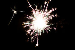 Pyrotechnic sparkler. Lighting equipment for New Year and Christmas. A sparkler is a type of hand-held firework equipment that burns slowly while emitting Royalty Free Stock Photo