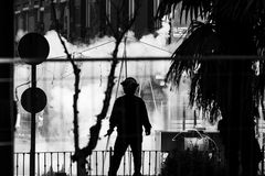 Pyrotechnic tecnician during the Fallas in Valencia. Silhouette of a pyrotechnic technician prepared for the Mascletà during the Fallas Festival in Valencia Royalty Free Stock Photos