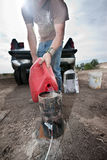 Pyrotechnic Worker Pouring Gasoline Stock Images