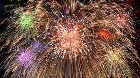 Pyrotechnics exploding. Colored pyrotechnics fireworks exploding at midnight royalty free stock photography