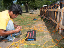 Pyrotechnics Setup. Workers set up pyrotechnic fireworks display of July 4th celebration Stock Photography