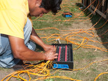Pyrotechnics Setup. Workers set up pyrotechnic fireworks display of July 4th celebration Stock Photos