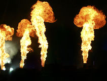 Pyrotechnics on stage. Four flames stock image