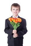 Pys i affärsdräkt med blommor som isoleras på vit Arkivfoto