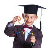 Pys i akademisk hatt fotografering för bildbyråer