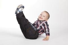 Pys med ben upp Arkivfoto