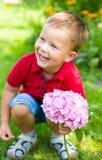 Pys med blommor Arkivfoto
