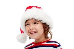 Pys med den santa hatten på huvudet Royaltyfria Bilder
