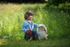 Pys med hans husdjur Arkivbilder