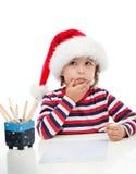 Pys som skrivar ett brev till jultomten Royaltyfri Bild