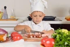 Pys som utbildar för att vara en kock Arkivbild
