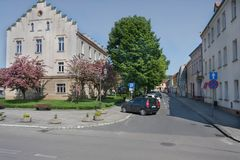 The square in Pyskowice with the town hall and with historic tenement houses. Royalty Free Stock Photo