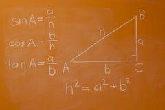 Pythagoras Theorem. On orange chalkboard with trigonometrical formula Stock Photo