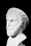 Pythagoras was an important Greek philosopher, mathematician, ge. Ometer and music theorist. White marble bust of him on black background Stock Photo