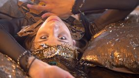 Python crawling on the face of young female dancer in bright costume. Close up stock video footage