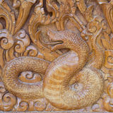 Snake on wood Stock Photos