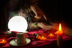 Pythoness woman reading future from palm. Pythoness fortune teller woman reading future from palm royalty free stock photos