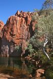 Pythons Pool. The rock face is reflected in the still waters of Python's Pool Stock Images