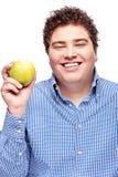 Pyzaty mężczyzna mienia jabłko fotografia stock