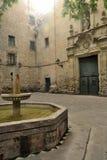 Pza. Sant Felip Neri. Plaza de San Felipe Neri, Barcelona. Bombed during the Spanish Civil War, the facade of the church retains the marks of shrapnel Stock Photography