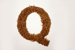 Q letter. the alphabet of buckwheat. Porridge. buckwheat grain. concept of healthy eating. photo for your design. horizontal sheet orientation royalty free stock photography