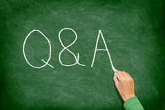 Q and A - Questions and Answers concept blackboard. Question and answer, support and help concept chalkboard concept with hand writing Stock Images