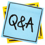 Q&A - questions and answers sign. Q&A - questions and answers sign - handwriting in black ink on isolated sticky note Royalty Free Stock Photos