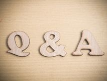 Q & A, Questions and Answers. Words Typography Concept. Q & A, Questions and Answers. Motivational internet business words quotes, wooden lettering typography royalty free stock photography