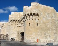 Qaitbay Citadel. Main gate, view from the street, Alexandria, Egypt Royalty Free Stock Images