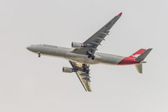 Qantas Airbus A330-200 on the background of clouds Royalty Free Stock Photos