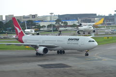 Qantas Airbus 330 taxiing at Changi Airport Stock Images