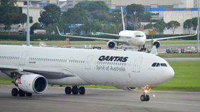 Qantas Airbus 330 taxiing to gate at Changi Airport Stock Photos
