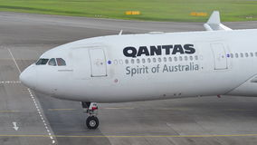 Qantas Airbus 330 taxiing to gate at Changi Airport Royalty Free Stock Images