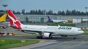 Qantas Airbus A330 widebody jet taxiing at Changi Airport Royalty Free Stock Photos