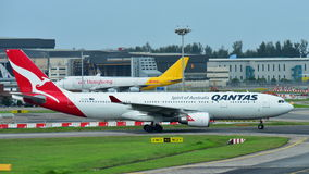 Qantas Airbus A330 widebody jet taxiing at Changi Airport Stock Photo