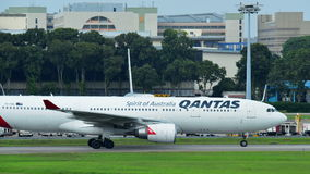 Qantas Airbus A330 widebody jet taxiing at Changi Airport Royalty Free Stock Photos