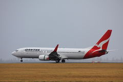 Qantas airliner. Qantas, the Spirit of Australia. Boeing 737-800 landing on a rainy day at airport Sydney Royalty Free Stock Photography