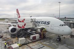 Qantas A380 airplane docked at Melbouren Airport. Melbourne, Australia - May 26, 2017: Qantas A380 airplane docked for loading luggage and catering at Melbourne Stock Image