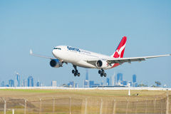 Qantas airplane landing at Melbourne Airport Stock Photography