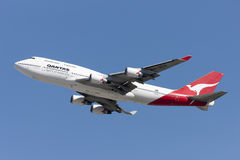 Qantas Airways Boeing 747 Jumbo Jet taking off from Los Angeles International Airport. Royalty Free Stock Photos