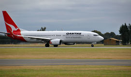 Qantas Boeing 737-800 Lands at Christchurch Royalty Free Stock Photo